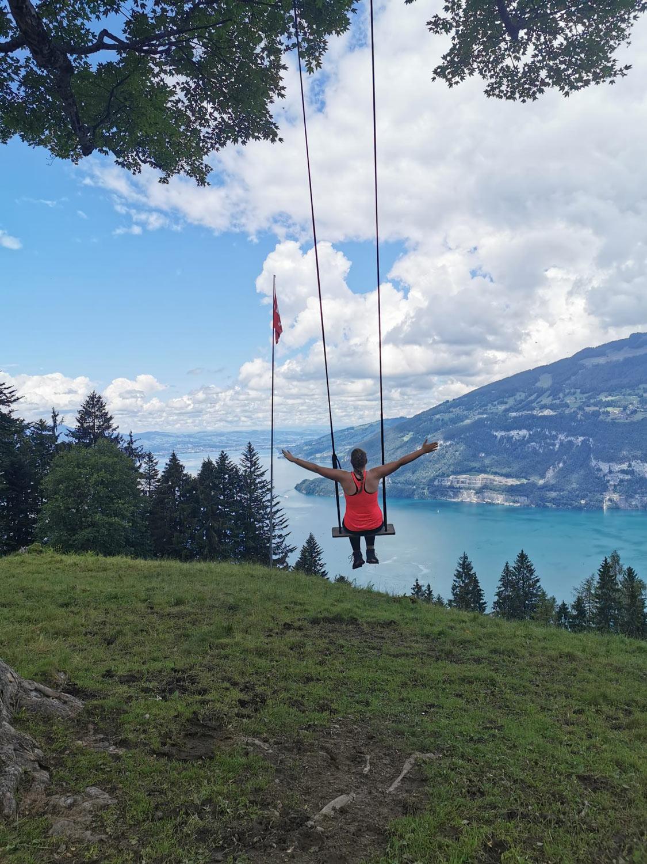 Woman on swing over lake Brienz